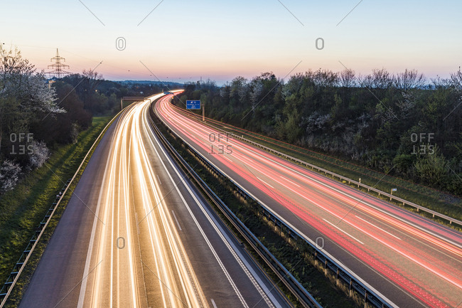 Germany- Baden-Wuerttemberg- traffic light trails on Autobahn A8 at dusk