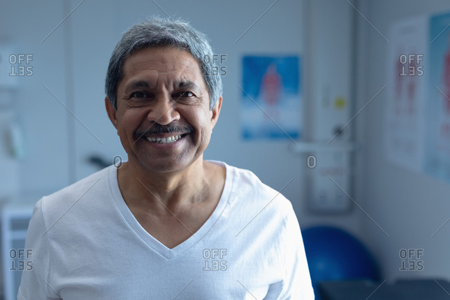 Portrait of mixed race male patient smiling in the ward at hospital