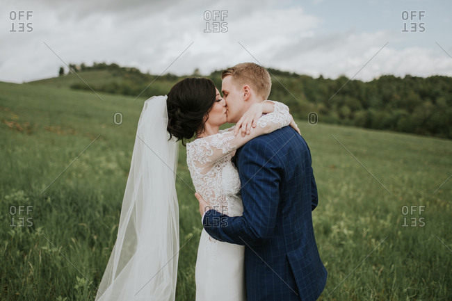 Bride and groom kissing on their wedding day.
