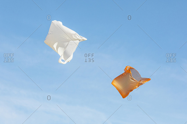 Two plastic bags flying in the air