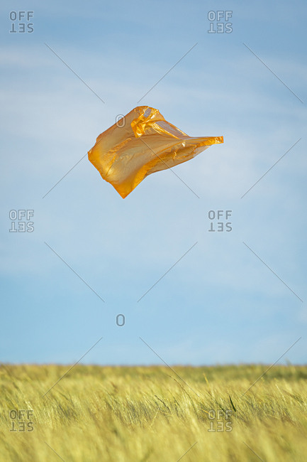 Orange plastic bag flying in the air