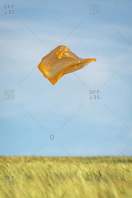 Orange plastic bag flying in the air
