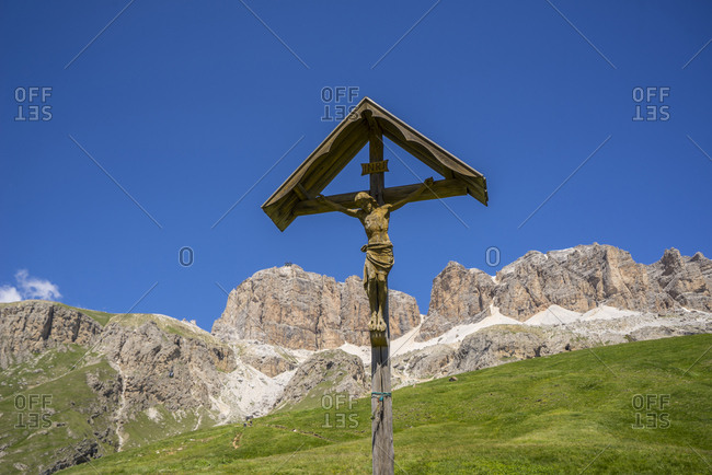 July 16, 2016: Italy, Trentino Alto Adige, Canazei . Pass Pordoi, 2239 mt. Wooden Crucifix along the mountain path