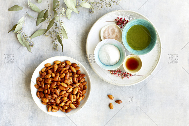 Plate of smoky almonds and seasoning ingredients