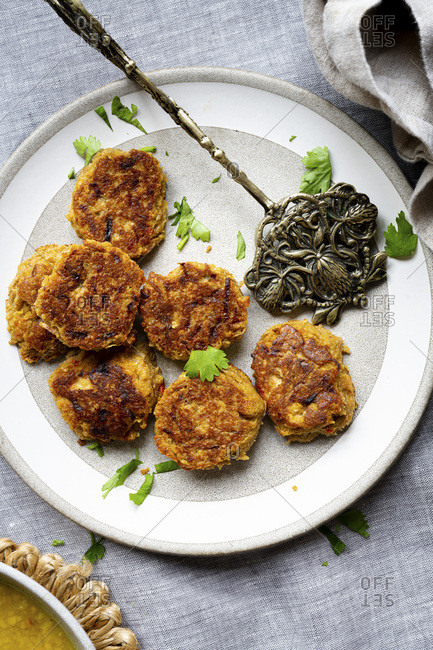 Sesame seed fritter, part of an Indian meal