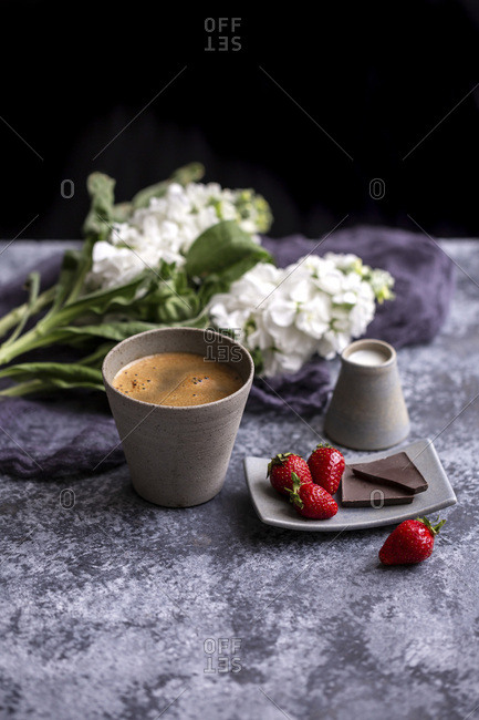 Cup of coffee, chocolate and strawberries