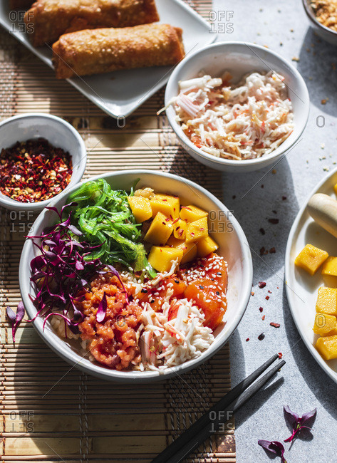 Dinner or lunch set: seafood poke bowl, egg rolls and crab meat in the bowl