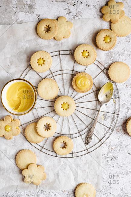 Assembling lemon custard linzer cookies