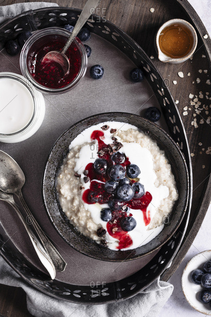Berry oatmeal served on metal tray