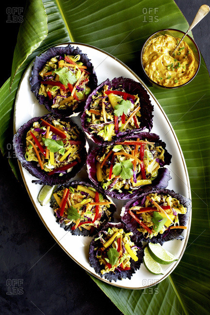 Peanut Slaw in red cabbage leaves