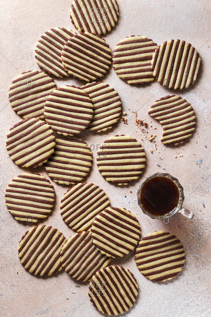 Striped cookies and a cup of coffee on the table