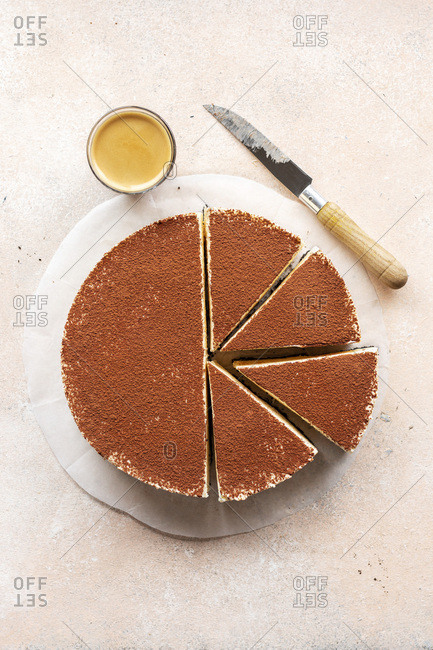 White chocolate cheesecake dusted with cocoa powder on the table