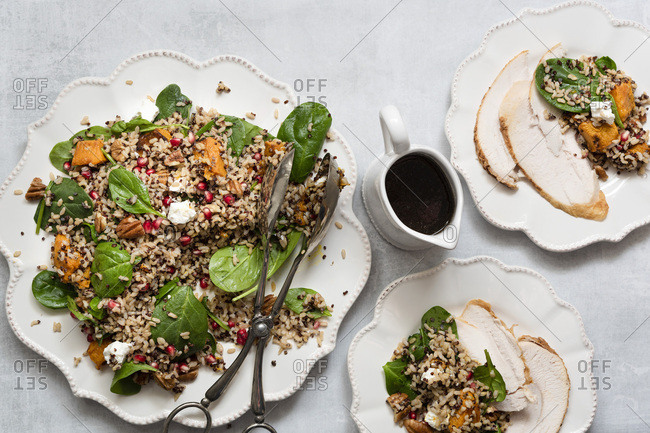 Roasted chicken breast served with a healthy rice, quinoa and pumpkin salad.