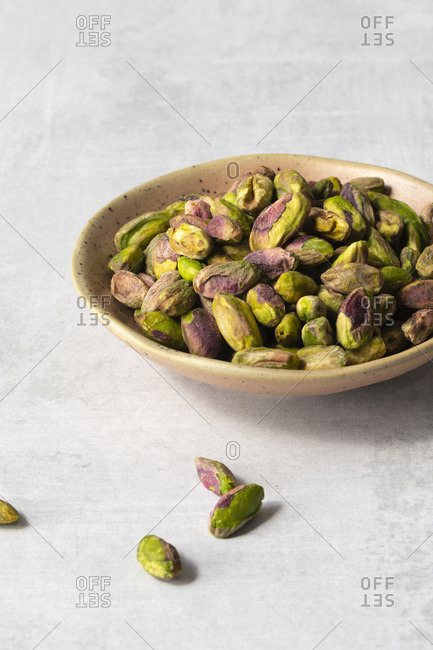 Pistachio nut kernels in a small bowl.