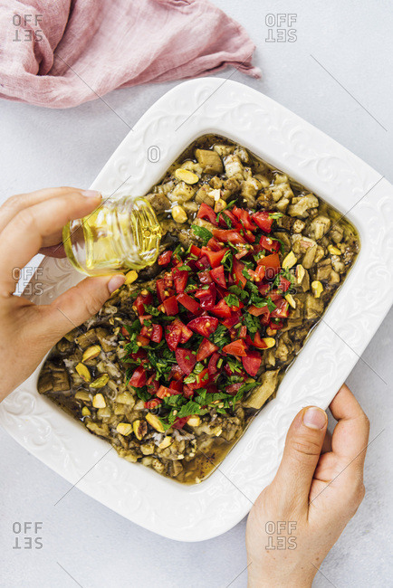 Drizzling olive oil over Turkish eggplant salad