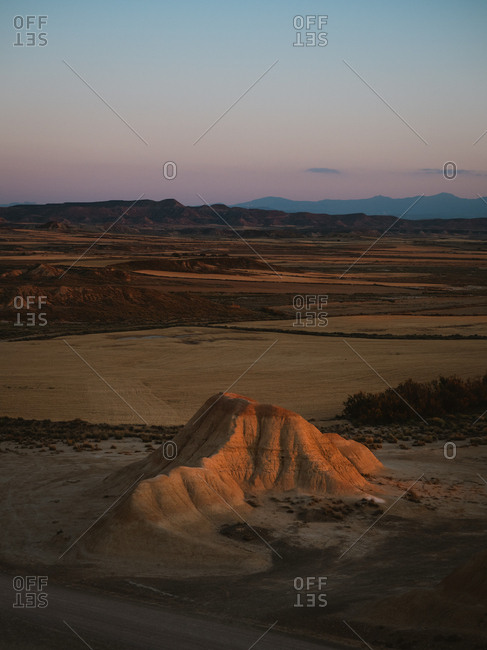 Desert geological formation illuminated by sunset golden light