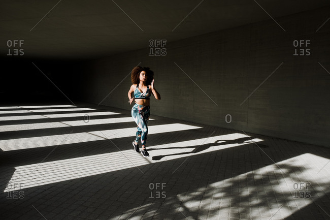 Curvy African American Woman Running In Urban Area