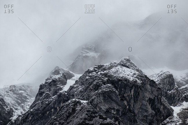 Snow topped mountains in heavy fog. Karwendelgebirge, Tyrol, Austria