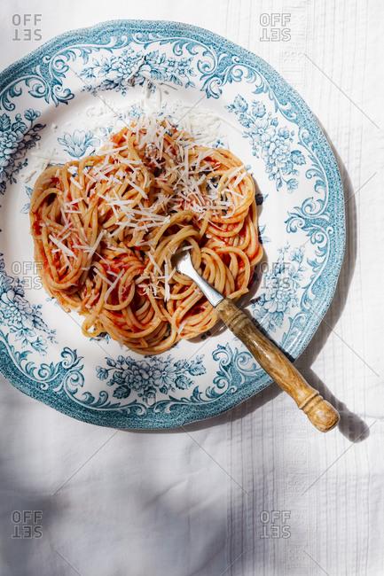 Plate of spaghetti in hard light