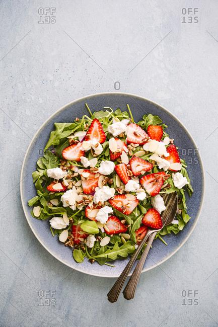 Plate of strawberry arugula salad