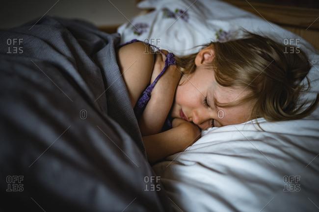 Little girl asleep in her bed
