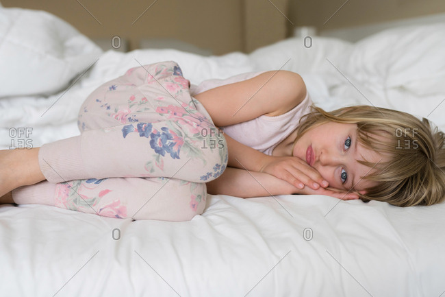 Young girl in her bed awake