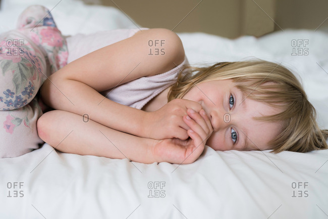 Little girl in her bed awake