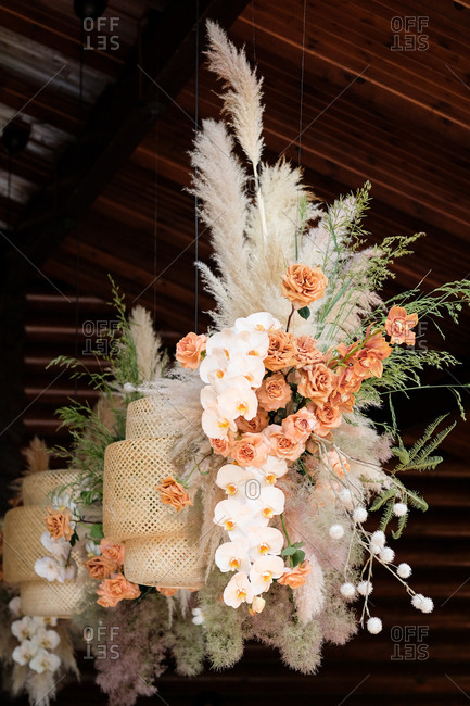 Beautiful wedding flower arrangement hanging from ceiling