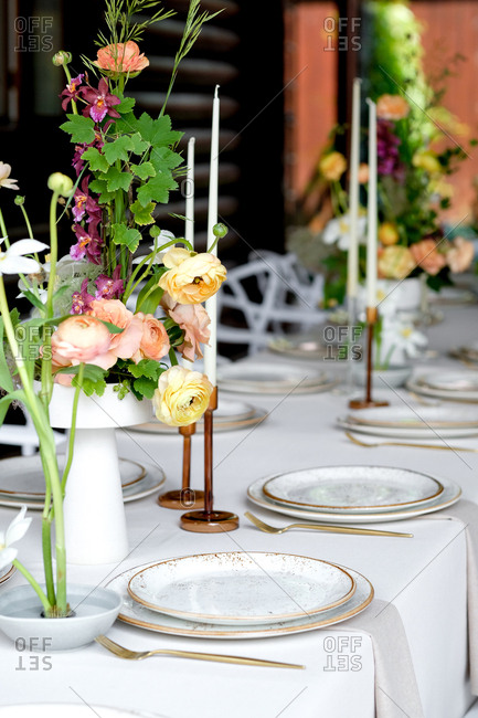 Colorful wedding flower centerpiece with candles
