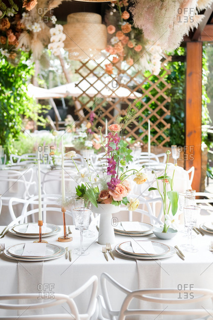 Set wedding reception table with floral centerpiece and candles