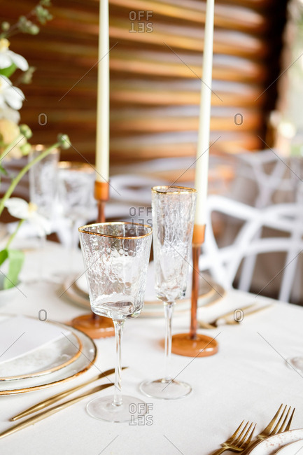 Set wedding reception table with wine glasses and candles