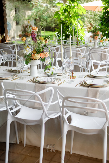 Wedding reception table with floral centerpiece and candles