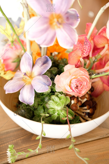 Colorful wedding flower centerpiece in a bowl