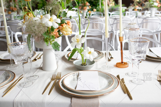 Set table at a wedding reception with floral centerpiece and candles