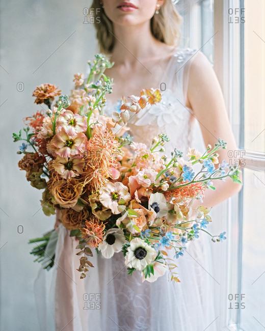 Bride holding large bouquet of artichokes