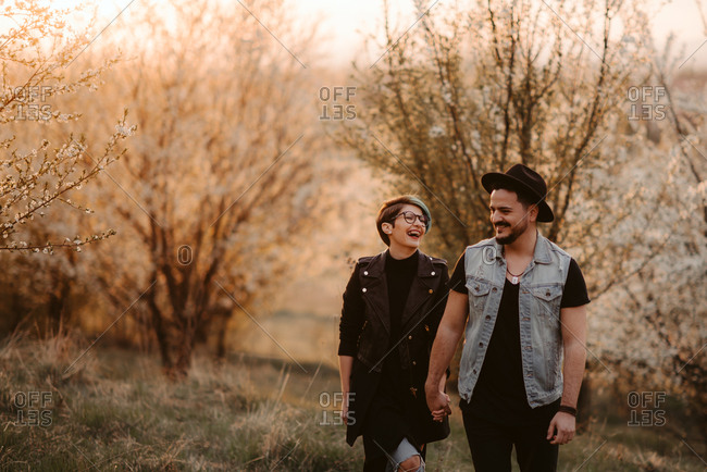 Couple holding hands and laughing together