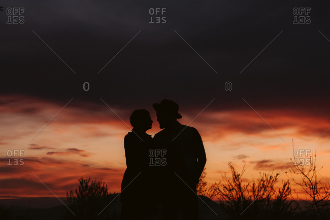 Silhouette of couple watching the sunset together