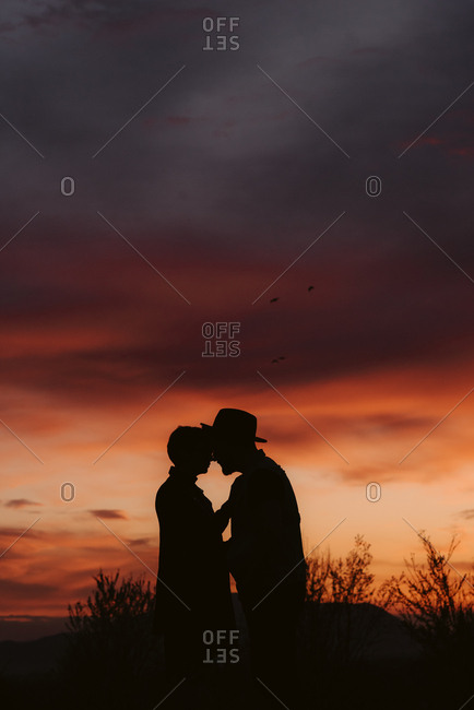Silhouette of couple together at sunset