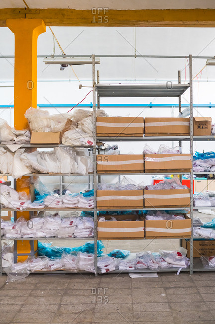 Shelves of fencing gear in a factory