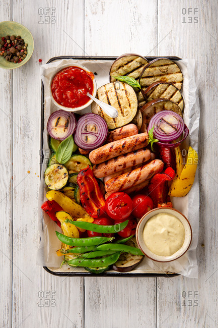 Grilled vegetables and sausage top view