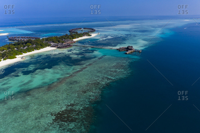 Maldives- South Male Atoll- lagoon of Olhuveli with sandy beach and water bungalow- aerial view
