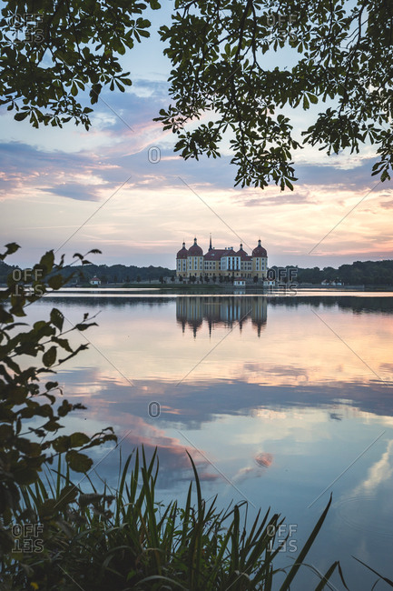 Germany- Saxony- Moritzburg Castle at castle pond in the evening
