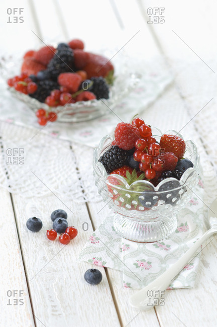 Glass bowl of various fresh fruits