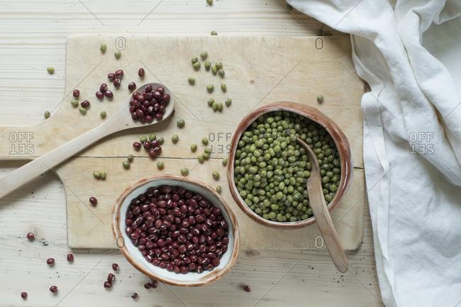 Split beans and Adzuki beans on wooden background