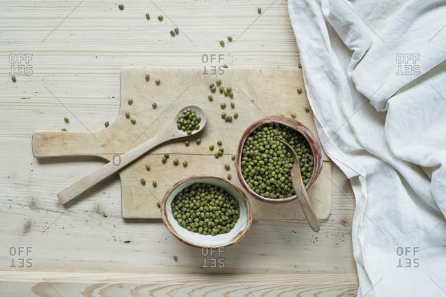 Split beans on wooden background