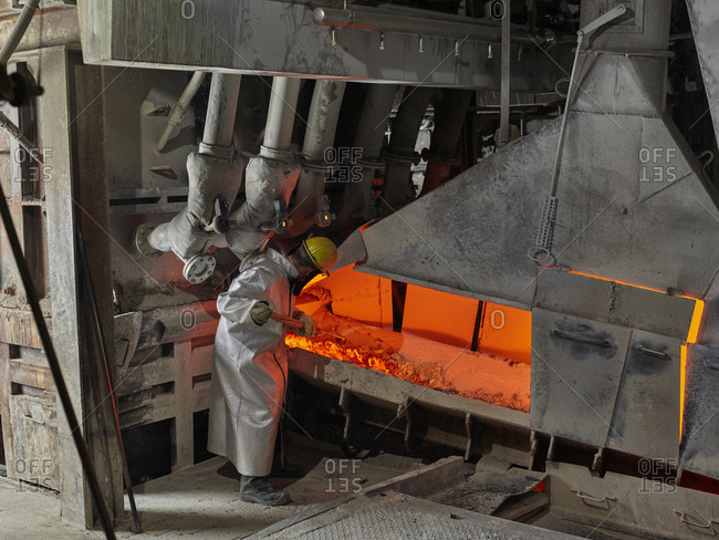 Industry- Worker controlling smelting process