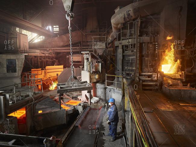 Industry- Smeltery- worker using indoor crane