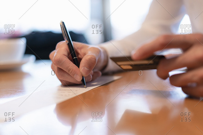 Man paying with credit card- close-up