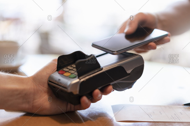 Contactless payment with smartphone- close-up