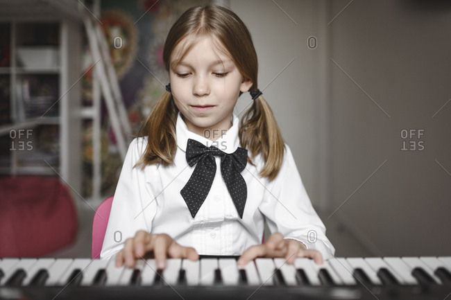 Portrait of a girl playing synthesizer